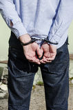 Bussinessman in handcuffs Stock Photography