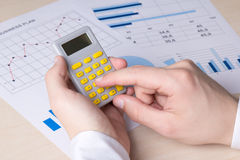 Bussinessman hands accounting something with calculator Stock Image