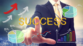 Bussinessman pointing at SUCCESS Stock Photo