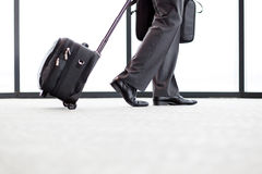 Bussinessman walking airport Royalty Free Stock Image