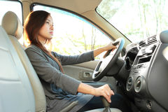 Bussinesswoman driving a car Royalty Free Stock Image
