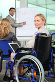 Bussinesswoman in wheelchair Stock Image