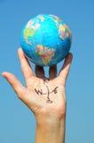 Bussola della mano con il globo Immagini Stock Libere da Diritti