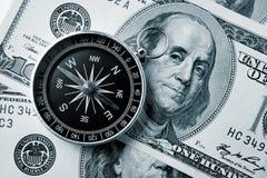 Bussola e soldi Fotografia Stock