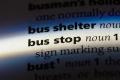 Busstop. Bus stop word in a dictionary. bus stop concept Stock Images