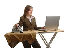 Bussy business woman ironing Royalty Free Stock Image