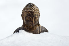 Buddha covered with snow Royalty Free Stock Photography