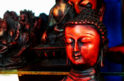 Bust of Buddha. Wooden bust of Buddha for sale at a local store in Kerala Royalty Free Stock Photo