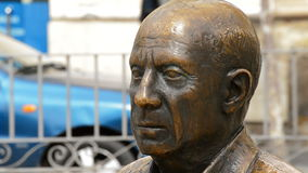 Bust with the face of spanish painter Pablo Ruiz Picasso in a park stock video footage