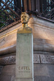 Bust of Gustave Eiffel in front of the Eiffel Tower in Paris, France. Royalty Free Stock Photo