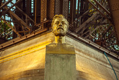 Bust of Gustave Eiffel in front of the Eiffel Tower in Paris, France. Stock Image