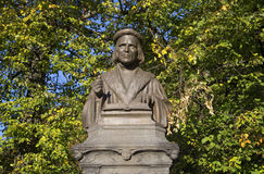 Bust of Mikael Agricola in the background of autumn foliage. Vyborg. Russia Royalty Free Stock Photography