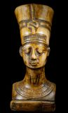 Bust of Queen Nefertiti. On the black background Royalty Free Stock Photo