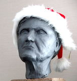 Bust with santa hat. Old woman with red and white santa hat Royalty Free Stock Photos
