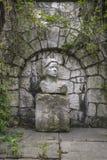 Bust sculpture. Of unknown in botanic garden in Krakow . Poland Royalty Free Stock Photo