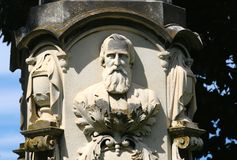 Bust Statue of a Bearded Man. Bust statue of a elderly man with a full beard on a gothic decorated stone pillar Stock Photos
