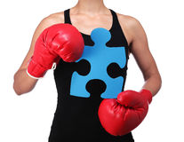 Bust of a woman boxer holding a puzzle piece. Photograph of a bust of a woman boxer holding a puzzle piece Stock Photography