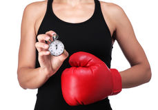 Bust of a woman boxer with a stopwatch. Photograph of a bust of a woman boxer with a stopwatch Royalty Free Stock Photography