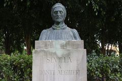 Bust the writer Dante Alighieri. The stone bust of the Italian writer Dante Alighieri in the Maria Luisa park in Seville, Andalusia Spain Stock Photos
