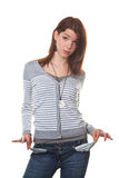 Bust young woman. Young teenage girl shows the empty pants pockets Royalty Free Stock Photos