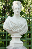 Bust of a young woman. A copy of the bust of a young woman. Workshop P.Baratt. Italy. Early. XVIII century. Marble. Sculpture of in old park Summer Garden in St Stock Photos