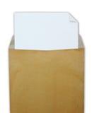 Busta marrone aperta con Libro Bianco fotografia stock