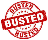 Busted red grunge round vintage stamp Royalty Free Stock Photo