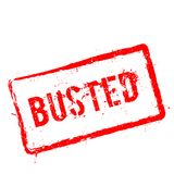 Busted red rubber stamp isolated on white. Busted red rubber stamp isolated on white background. Grunge rectangular seal with text, ink texture and splatter and Stock Photos