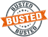 Busted round grunge stamp Royalty Free Stock Images