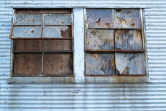 Busted Windows Blight. Broken and boarded up windows, an example of urban blight Stock Image