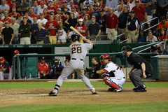 Buster Posey al pipistrello sulla strada contro Washington Nationals Fotografia Stock