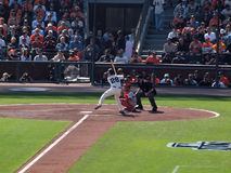 Buster Posey lifts foot as he prepares to swings at pitch. SAN FRANCISCO, CA - OCTOBER 19: San Francisco Giants vs. Philadelphia Phillies: Buster Posey lifts Royalty Free Stock Images