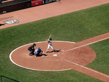 Buster Posey stands in batters box waiting. Giants Vs. Cubs: Giants Buster Posey stands in batters box waiting for pitch with Cubs catcher squating behind him Royalty Free Stock Image