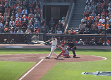 Buster Posey swings at pitch. SAN FRANCISCO, CA - OCTOBER 19: San Francisco Giants vs. Philadelphia Phillies: Buster Posey swings at pitch as catcher reaches for Stock Image