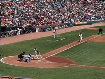 Buster Posey waits for pitch from Randy Wells. Giants Vs. Cubs: Giants Buster Posey makes contact with pitch from Cubs Randy Wells with Freddy Sanchez taking Royalty Free Stock Photos