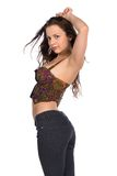 Bustier. Pretty petite brunette in a bustier top and jeans royalty free stock photos