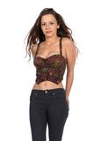 Bustier. Pretty petite brunette in a bustier top and jeans royalty free stock images