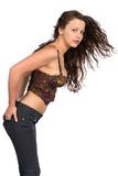 Bustier. Pretty petite brunette in a bustier top and jeans stock photo