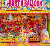 Busting Balloon Game At A Funfair. MACKAY, QUEENSLAND, AUSTRALIA - JUNE 2019: A game of chance busting balloons to win a price at Mackay Annual Show stock image