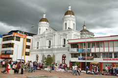 Bustle in the maketplace with the church behind, Latacunga Stock Photography