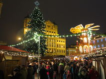 Christmas market bustling by night. The traditional Christmas market at the historic town square in the city Augsburg (Bavaria, Germany). Decorated Royalty Free Stock Photos