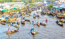Bustling boat trips reverse sweep on morning floating market Stock Photography