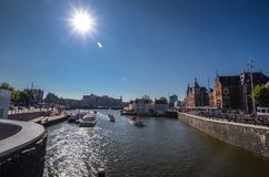 Bustling canal in the middle of the capital city. Bustling canal in the middle of the capital city Amsterdam stock image