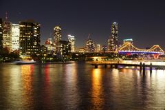Bustling night city views. Busy city by night with Brisbane city light, lit up story bridge stock photography