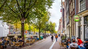 Oudezijds Voorburgwal in the city center of Amsterdam,. The bustling Oudezijds Voorburgwal, a famous canal street in the heart of the red light district in the royalty free stock photo