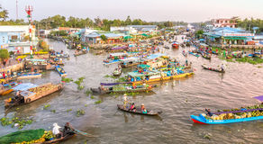 Bustling scene the morning floating market on the river Stock Photos