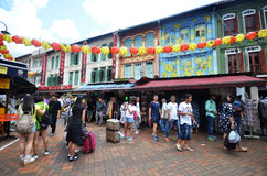 Bustling street of Chinatown district in Singapore Stock Images