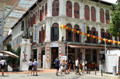 Bustling street of Chinatown district in Singapore Stock Photo