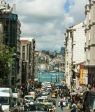 Bustling street in Istanbul's lively city-hood with Bosporus in. Bustling street in Istanbul´s city center with view on the Bosporus river royalty free stock image