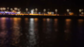 Bustling traffic on the waterfront at night. Hd stock video footage